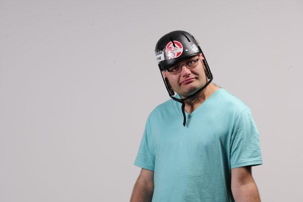 Disabled man wearing helmet