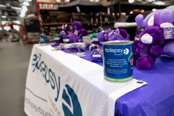 Epilepsy Foundation donation tin on table