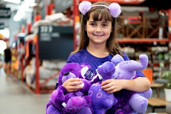 Girl with Epilepsy Foundation plush toys