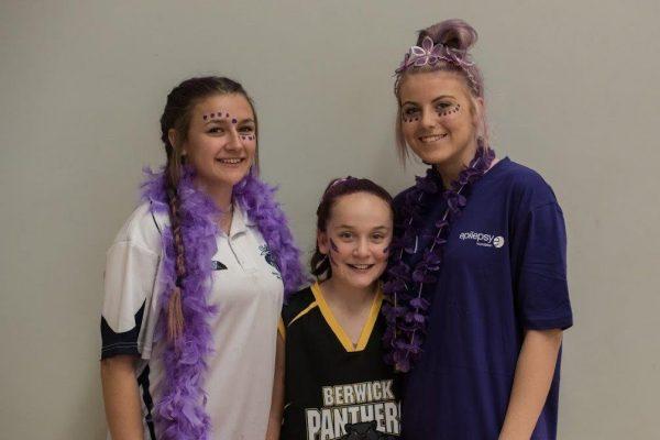 Three girls at purple day event