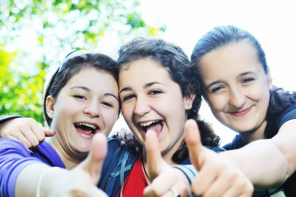 Three girls with thumbs up