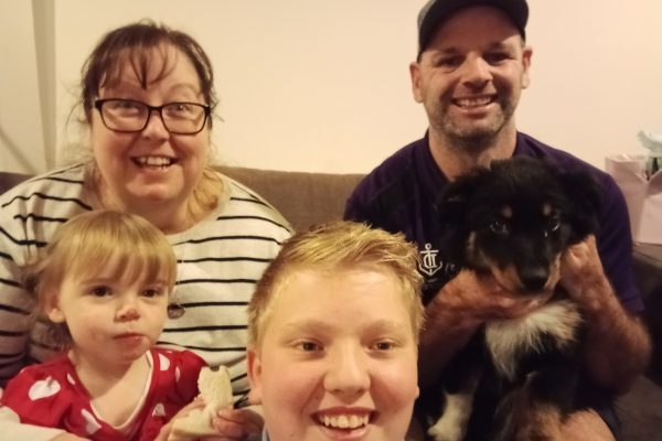 Family with new puppy Lexi